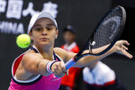 FILE - In this Oct. 4, 2019, file photo, Ashleigh Barty, of Australia, hits a backhand shot against Petra Kvitova, of the Czech Republic, during a women's singles quarterfinal match in the China Open tennis tournament at the Diamond Court in Beijing. Barty is ready to cap off the most successful season of her career with a first appearance in the year-end WTA Finals. (AP Photo/Mark Schiefelbein, File)