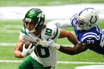 New York Jets wide receiver Braxton Berrios (10) is tackled by Indianapolis Colts cornerback Xavier Rhodes (27) in the first half of an NFL football game in Indianapolis, Sunday, Sept. 27, 2020. (AP Photo/AJ Mast)