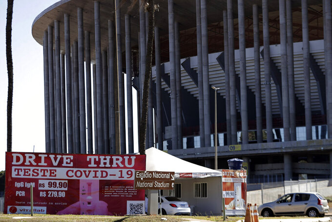A COVID-19 testing site stands outside the National Stadium in Brasilia, Brazil, Friday, June 4, 2021. The National Stadium will host some Copa America soccer games. (AP Photo/Eraldo Peres)