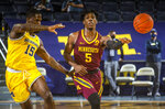 Michigan guard Chaundee Brown Jr. (15) defends Minnesota guard Marcus Carr (5) in the first half of an NCAA college basketball game at Crisler Center in Ann Arbor, Mich., Wednesday, Jan. 6, 2021. (AP Photo/Tony Ding)