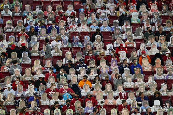 Fans sit among cardboard cutouts before the NFL Super Bowl 55 football game between the Kansas City Chiefs and Tampa Bay Buccaneers, Sunday, Feb. 7, 2021, in Tampa, Fla. (AP Photo/Charlie Riedel)