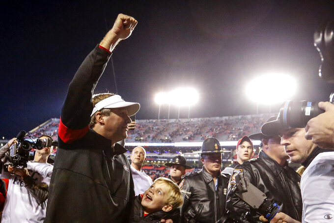 Georgia head coach Kirby Smart celebrates as he walks off the field after the team defeated Auburn 21-14 in an NCAA college football game, Saturday, Nov. 16, 2019, in Auburn, Ala. (AP Photo/Butch Dill)