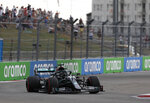 Mercedes driver Lewis Hamilton of Britain steers his car during the qualifying session for the upcoming Russian Formula One Grand Prix, at the Sochi Autodrom circuit, in Sochi, Russia, Saturday, Sept. 26, 2020. The Russian Formula One Grand Prix will take place on Sunday. (Yuri Kochetkov, Pool Photo via AP)