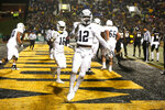 Georgia Southern running back Wesley Kennedy III (12) celebrates his touchdown during the first half of the team's NCAA college football game against Appalachian State on Thursday, Oct. 31, 2019, in Boone, N.C. (AP Photo/Brian Blanco)