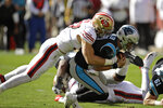 Carolina Panthers quarterback Kyle Allen is sacked by San Francisco 49ers defensive end Nick Bosa during the first half of an NFL football game in Santa Clara, Calif., Sunday, Oct. 27, 2019. (AP Photo/Ben Margot)