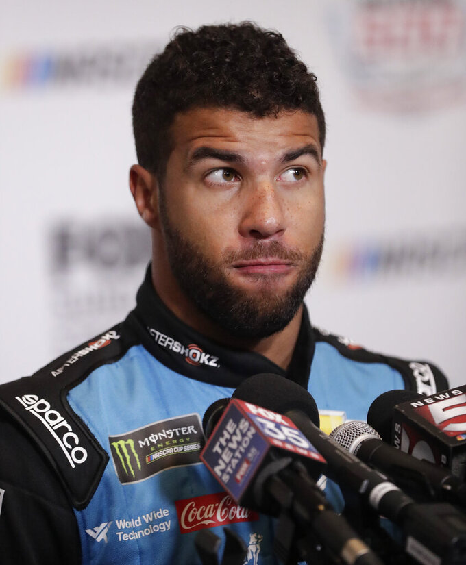 Darrell Wallace Jr. takes a moment before answering a question during an interview at NASCAR Daytona 500 auto racing media day at Daytona International Speedway, Wednesday, Feb. 13, 2019, in Daytona Beach, Fla. (AP Photo/John Raoux)