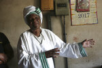 72-year old grandmother Esther Zinyoro Gwena is seen in her a tiny apartment in the poor surburb of Mbare in Harare, Zimbabwe, Saturday, Nov. 16, 2019. Grandmother Esther Zinyoro Gwena claims to be guided by the holy spirit and has become a local hero, as the country's economic crisis forces closure of medical facilities, and mothers-to-be seek out untrained birth attendants.(AP Photo/Tsvangirayi Mukwazhi)