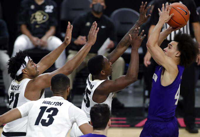 Washington's Nate Pryor (4) shoots against Colorado during the first half of an NCAA college basketball game, Sunday, Dec. 20, 2020, in Las Vegas. (AP Photo/Isaac Brekken)