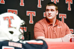 Robert E. Lee offensive lineman Beaux Limmer sits on stage during a national signing day event at Robert E. Lee High School in Tyler, Texas, Wednesday, Dec. 19, 2018. Limmer announced his intentions to attend the University of Arkansas to play college football. (Chelsea Purgahn/Tyler Morning Telegraph via AP)