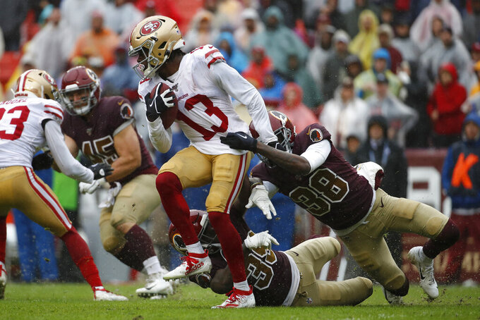 San Francisco 49ers wide receiver Richie James (13) rushes against Washington Redskins defensive backs Simeon Thomas (38) and Jeremy Reaves (39) in the second half of an NFL football game, Sunday, Oct. 20, 2019, in Landover, Md. (AP Photo/Alex Brandon)