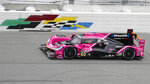 The Meyer Shark Racing Acura DPi takes in laps during a practice session for the Rolex 24 hour auto race at Daytona International Speedway, Saturday, Jan. 23, 2021, in Daytona Beach, Fla. (AP Photo/John Raoux)