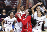 Georgia center Jenna Staiti prepares to shoot against South Carolina defenders, including forward Victaria Saxton (5) and Aliyah Boston, left, during the second half of an NCAA college basketball game Thursday, Jan. 21, 2021, in Columbia, S.C. (AP Photo/Sean Rayford)