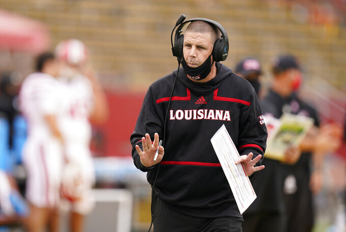 FILE  - Louisiana-Lafayette head coach Billy Napier directs his team from the sideline during the second half of an NCAA college football game against Iowa State in Ames, Iowa, in this Saturday, Sept. 12, 2020, file photo. Louisiana-Lafayette won 31-14. No. 25 Louisiana-Lafayette is on track for one of the best seasons in program history under coach Billy Napier. But it could come crashing down this week if the Ragin' Cajuns stumble against South Alabama. (AP Photo/Charlie Neibergall, FIle)