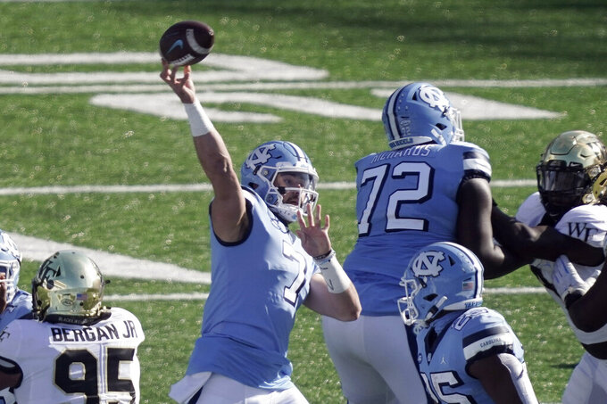 FILE - In this Nov. 14, 2020, file photo, North Carolina quarterback Sam Howell (7) passes against Wake Forest during the first half of an NCAA college football game in Chapel Hill, N.C. Howell's 25th-ranked Tar Heels host No. 2 Notre Dame on Friday. (AP Photo/Gerry Broome, File)