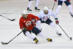 Washington Capitals left wing Alex Ovechkin (8), foreground, runs a play as defenseman Justin Schultz (2) defends during NHL hockey practice at the MedStar Capitals Iceplex in Arlington, Va., Tuesday, Jan. 5, 2020. (Ricky Carioti/The Washington Post via AP)