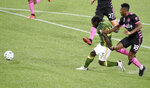 Portland Timbers forward Yimmi Chara (23) scores a goal as Seattle Sounders' Yeimar Gomez, right, defends during the first half of an MLS soccer match in Portland, Ore., Wednesday, Sept. 23, 2020. (AP Photo/Steve Dykes)