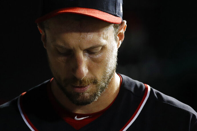 Washington Nationals starting pitcher Max Scherzer walks in the dugout in the bottom of the fifth inning of the team's baseball game against the Atlanta Braves, Friday, Sept. 13, 2019, in Washington. Atlanta scored a run against Scherzer in the fifth; he did not return for the sixth. (AP Photo/Patrick Semansky)