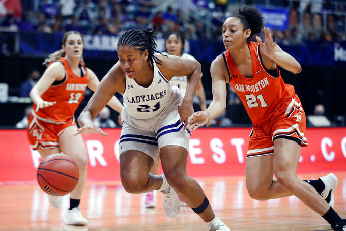 Stephen F. Austin forward Aiyana Johnson (21) chases a loose ball in front of Sam Houston State forward Madelyn Batista (21) during the first half of an NCAA college basketball game for the Southland Conference women's tournament championship Sunday, March 14, 2021, in Katy, Texas. (AP Photo/Michael Wyke)