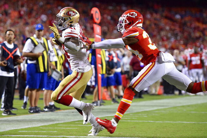 San Francisco 49ers running back Jeff Wilson (41) runs for a touchdown in front of Kansas City Chiefs cornerback Herb Miller (34) during the second half of an NFL preseason football game in Kansas City, Mo., Saturday, Aug. 24, 2019. (AP Photo/Ed Zurga)