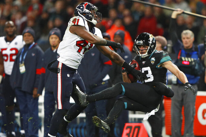 Houston Texans inside linebacker Zach Cunningham (41) hits Jacksonville Jaguars Michael Walker during the second half of an NFL football game at Wembley Stadium, Sunday, Nov. 3, 2019, in London. (AP Photo/Ian Walton)
