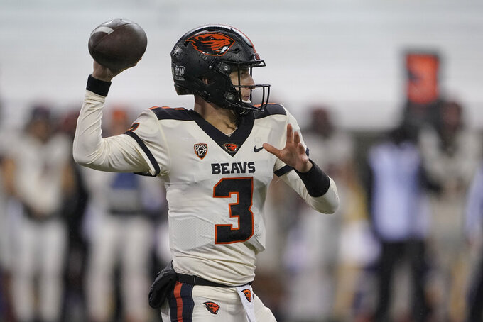 Oregon State quarterback Tristan Gebbia throws a pass during the first half of the team's NCAA college football game against Washington, Saturday, Nov. 14, 2020, in Seattle. (AP Photo/Ted S. Warren)