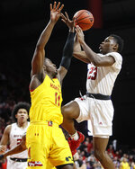 Rutgers' Montez Mathis (23) shoots over Maryland's Darryl Morsell (11) during the second half of an NCAA college basketball game Tuesday, March 3, 2020, in Piscataway, N.J. (AP Photo/John Minchillo)