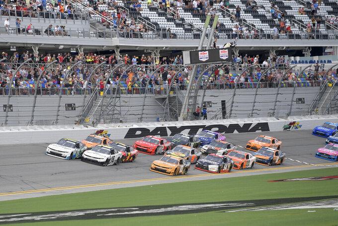 Justin Haley (11) takes the checkered flag in front of AJ Allmendinger (16) to win a NASCAR Xfinity Series auto race at Daytona International Speedway, Saturday, Aug. 28, 2021, in Daytona Beach, Fla. (AP Photo/Phelan M. Ebenhack)