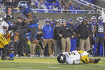 Kentucky running back Asim Rose (10) runs for a touchdown during the first half of NCAA college football game against Missouri, Saturday, Oct. 26, 2019, in Lexington, Ky. (AP Photo/Bryan Woolston)