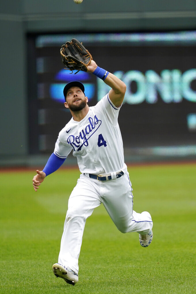 Kansas City Royals left fielder Alex Gordon catches a fly ball hit by Detroit Tigers Niko Goodrum during the first inning of a baseball game at Kauffman Stadium in Kansas City, Mo., Sunday, Sept. 27, 2020. (AP Photo/Orlin Wagner)