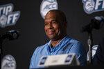 North Carolina head coach Hubert Davis smiles during NCAA college basketball Atlantic Coast Conference media day, Tuesday, Oct. 12, 2021, in Charlotte, N.C. (AP Photo/Matt Kelley)