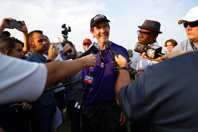Coach Art Briles addresses the media after a team practice at Mount Vernon High School, Monday, Aug. 5, 2019, in Mount Vernon, Texas. Briles was back at his roots Monday, coaching a high school football team in Texas after a season in Italy and more than three years after the two-time Big 12 champion coach was fired by Baylor in the wake of a sexual assault scandal. (AP Photo/Tony Gutierrez)