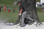 Kevin Kisner hits out of the sand on the 16th hole during the second round of The Players Championship golf tournament Friday, March 15, 2019, in Ponte Vedra Beach, Fla. (AP Photo/Gerald Herbert)