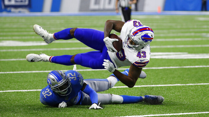 Buffalo Bills tight end Keith Towbridge (43) is brought down by Detroit Lions defensive back Tavon Wilson (32) during the second half of an NFL preseason football game in Detroit, Friday, Aug. 23, 2019. (AP Photo/Rick Osentoski)
