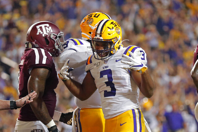 LSU running back Tyrion Davis-Price (3) celebrates his touchdown run against Texas A&M during the first half of an NCAA college football game in Baton Rouge, La., Saturday, Nov. 30, 2019. (AP Photo/Gerald Herbert)