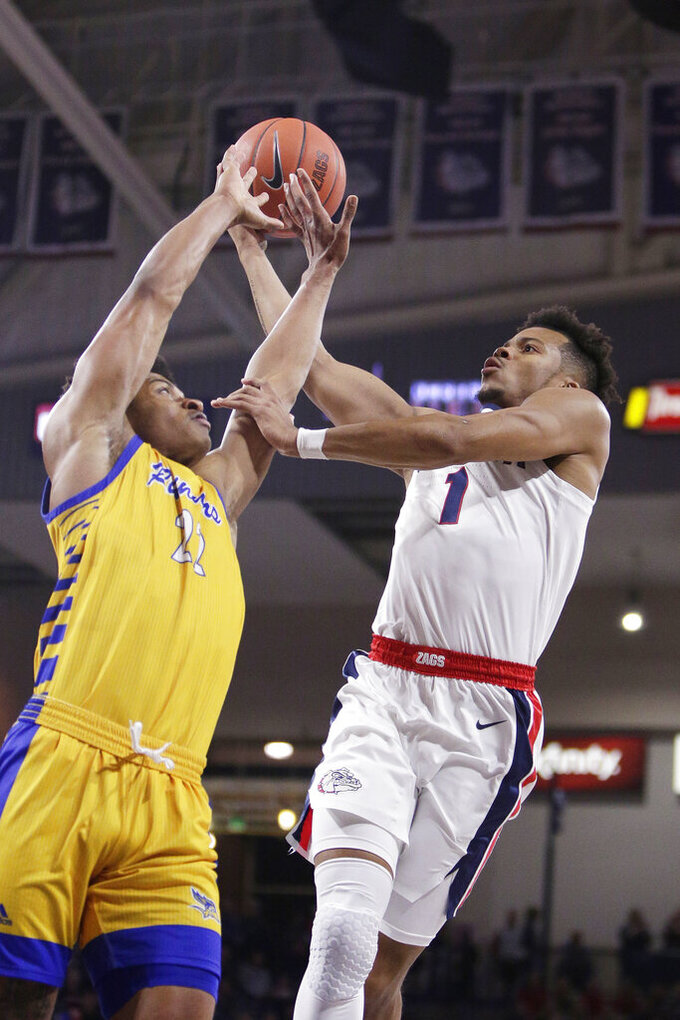 Gonzaga guard Admon Gilder (1) shoots over Cal State Bakersfield guard Justin McCall (22) during the first half of an NCAA college basketball game in Spokane, Wash., Saturday, Nov. 23, 2019. (AP Photo/Young Kwak)