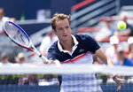 Daniil Medvedev, of Russia, goes up to the net to return to Dominic Thiem, of Austria, during quarterfinal play at the Rogers Cup tennis tournament in Montreal, Friday, Aug. 9, 2019. (Paul Chiasson/The Canadian Press via AP)