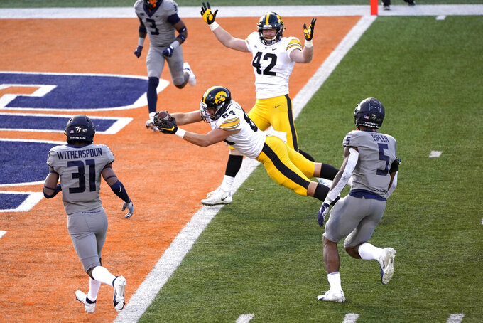Iowa tight end Sam LaPorta dives into the end zone for a touchdown during the first half of an NCAA college football game against Illinois Saturday, Dec. 5, 2020, in Champaign, Ill. (AP Photo/Charles Rex Arbogast)