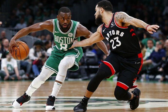 Boston Celtics' Kemba Walker (8) drives past Toronto Raptors' Fred VanVleet (23) during the first half of an NBA basketball game in Boston, Friday, Oct. 25, 2019. (AP Photo/Michael Dwyer)