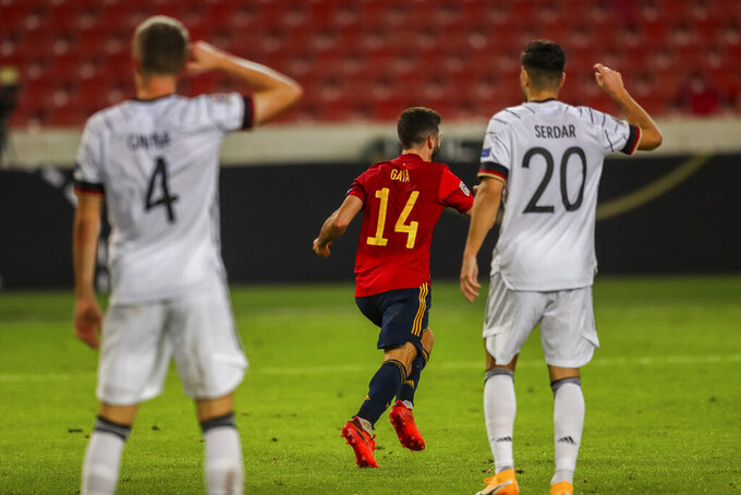 Spain's Luis Jose Gaya, center, celebrates after scoring during the UEFA Nations League soccer match against Germany at the Mercedes-Benz Arena stadium in Stuttgart, Germany, Thursday, Sept. 3, 2020. (AP Photo/Matthias Schrader)