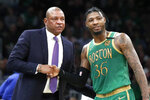 Los Angeles Clippers head coach Doc Rivers, left, greets Boston Celtics guard Marcus Smart (36) during a break in the first quarter of an NBA basketball game, Thursday, Feb. 13, 2020, in Boston. (AP Photo/Elise Amendola)