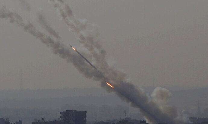 Rockets are launched from Gaza Strip to Israel, Tuesday, Nov. 12, 2019. Israel killed a senior Islamic Jihad commander in Gaza early Tuesday in a resumption of pinpointed targeting that threatens a fierce round of cross-border violence with Palestinian militants. (AP Photo/Hatem Moussa)