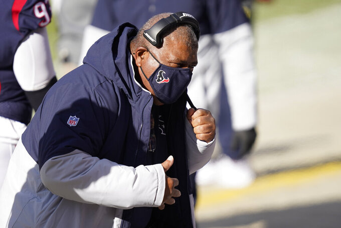 Houston Texans interim head coach Romeo Crennel talks with the defensive line during the first half of an NFL football game against the Chicago Bears, Sunday, Dec. 13, 2020, in Chicago. (AP Photo/Charles Rex Arbogast)