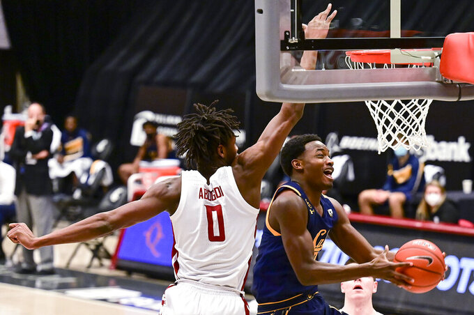 California guard Jalen Celestine (32) attempts a layup as Washington State center Efe Abogidi (0) defends during the first half of an NCAA college basketball game Thursday, Feb. 18, 2021, in Pullman, Wash. (AP Photo/Pete Caster)