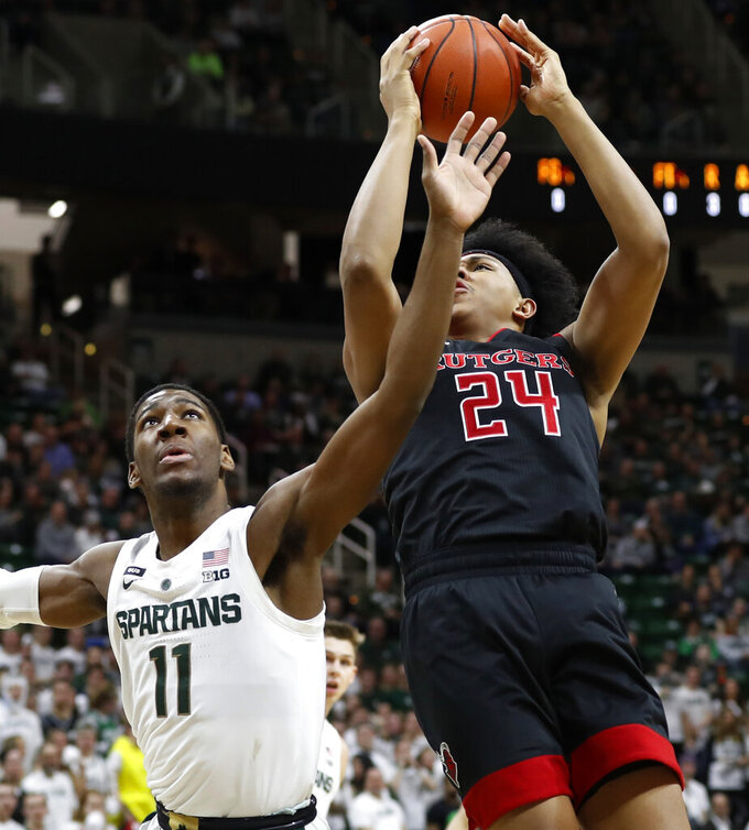 Rutgers forward Ron Harper Jr. (24) makes a layup as Michigan State forward Aaron Henry (11) defends during the first half of an NCAA college basketball game Wednesday, Feb. 20, 2019, in East Lansing, Mich. (AP Photo/Carlos Osorio)