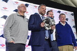 Carolina Panthers team owner, David Tepper, from left, poses with new head coach Matt Rhule, team president of business Tom Glick and general manager Marty Hurney during a news conference at the teams practice facility, Wednesday, Jan. 8, 2020, in Charlotte, N.C. (AP Photo/Mike McCarn)