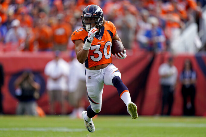Denver Broncos running back Phillip Lindsay (30) runs the ball against the Chicago Bears during the first half of an NFL football game, Sunday, Sept. 15, 2019, in Denver. (AP Photo/Jack Dempsey)