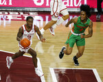 Oklahoma's Umoja Gibson (2) is defended by Florida A&M's Jahvon Smith (0) during the second half of an NCAA college basketball game in Norman, Okla., Saturday, Dec. 12, 2020. (AP Photo/Garett Fisbeck)