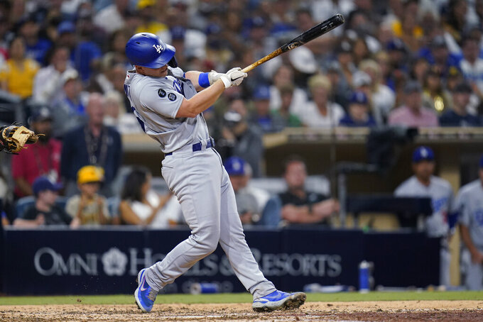 Los Angeles Dodgers' Will Smith follows through on a home run during the eighth inning of the team's baseball game against the San Diego Padres, Wednesday, Aug. 25, 2021, in San Diego. (AP Photo/Gregory Bull)