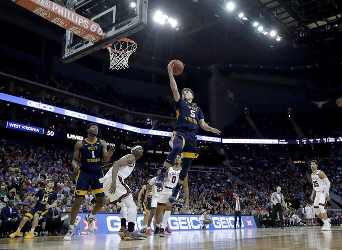 West Virginia's Jordan McCabe (5) shoots during the second half of the team's NCAA college basketball game against Texas Tech in the Big 12 men's tournament Thursday, March 14, 2019, in Kansas City, Mo. West Virginia won 79-74. (AP Photo/Charlie Riedel)