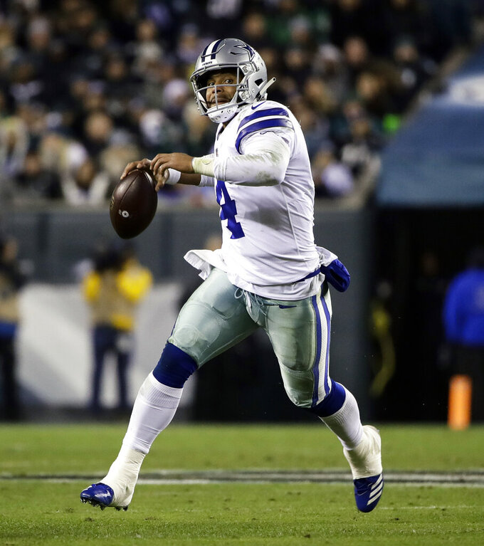 FILE - In this Nov. 11, 2018, file photo, Dallas Cowboys quarterback Dak Prescott (4) in action during an NFL football game against the Philadelphia Eagles, in Philadelphia. The Los Angeles Rams and Cowboys meet in a divisional playoff game on Saturday, Jan. 12, 2019.(AP Photo/Matt Rourke, File)